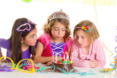 Children happy girls blowing birthday party cake Stock Photography