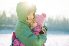Children happy hug backlight playing outside Royalty Free Stock Image
