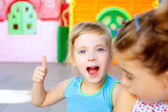 Children happy little sister girls with ok gesture stock images