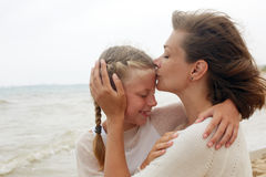 Children and happy parent concept - hugging mother and daughter Royalty Free Stock Images