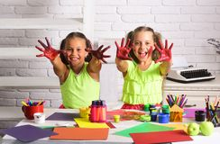 Children happy smiling with colored hands Royalty Free Stock Photo