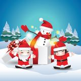 Children happy with snowman in gift box stock photography