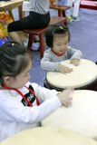 Children happy to beat the drum. China international musical instruments exhibition held in november 2016 11-13 at the xiamen international convention and royalty free stock photos