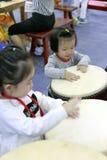 Children happy to beat the drum Royalty Free Stock Photos