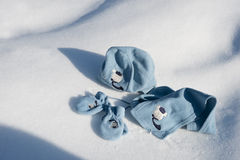 Children hat, scarf and gloves on the snow Stock Photo