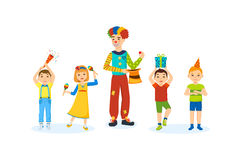 Children have fun with a clown animator home in room. Concept of illustration - children party indoor. Small happy kids, play, have fun with a clown animator Royalty Free Stock Image