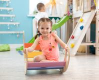 Child is playing in the children`s room. Children in the entertainment center. Fun in the children`s playroom stock image
