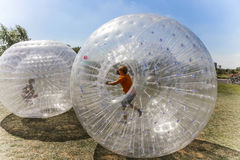 Children have fun in the Zorbing Ball Royalty Free Stock Photo