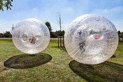 Children have fun in the Zorbing Ball Royalty Free Stock Image