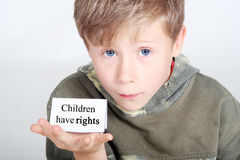 Children have rights. Young boy with a shield children have rights Stock Image