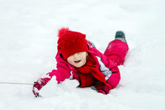 Children have a roll in the snow Royalty Free Stock Photo