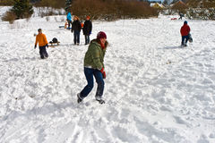 Children have a snowball fight in the white snowy area Royalty Free Stock Images