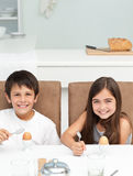 Children having breakfast in the kitchen Royalty Free Stock Image