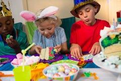 Children having cake Stock Images