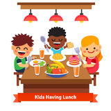 Children having dinner at the kindergarten of home Royalty Free Stock Photos