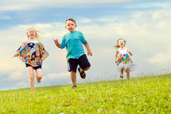 Children having a foot race Stock Photo