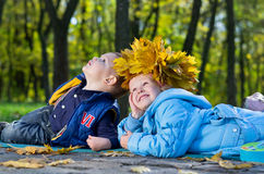 Children having fun in an autumn park Stock Images