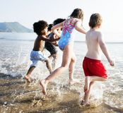 Children having fun on the beach Stock Images
