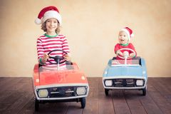Children having fun at Christmas time royalty free stock images