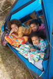 Children Having Fun Inside Tent On Camping Holiday. Smiling At Camera stock photos