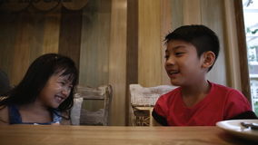 Children having fun, little Asian kids playing together on the table.  stock footage