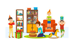 Children having fun in living room on a holiday evening. Royalty Free Stock Image