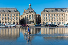 Children having fun in a mirror fountain in Bordeaux Royalty Free Stock Image