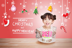Children having fun at new year party with cake and candle 2017.  Stock Photo