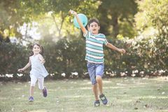 Children having fun outdoors concept stock images