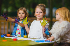 Children having fun painting with finger paint Royalty Free Stock Images