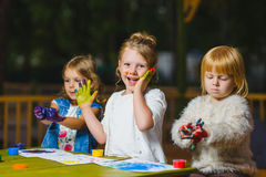 Children having fun painting with finger paint Stock Photography
