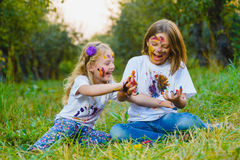 Children having fun painting with finger paint Royalty Free Stock Photos