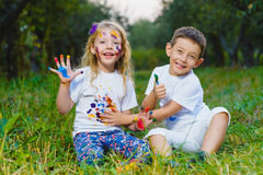 Children having fun painting with finger paint Stock Images