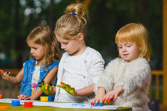 Children having fun painting with finger paint Stock Photo