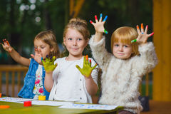 Children having fun painting with finger paint Stock Photos