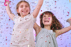 Children having fun at the party. Studio portrait of two joyful children having fun and dancing at the party Royalty Free Stock Photos