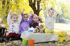 Children having fun on picnic at fall. Children having fun on picnic under autumn trees Stock Photo