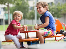 Children having fun at playground Royalty Free Stock Photo