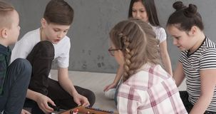 Children having fun playing foosball at home. Boys and girls having fun while playing foosball at home stock footage