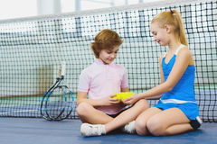 Children having fun and playing on the tennis court Royalty Free Stock Image