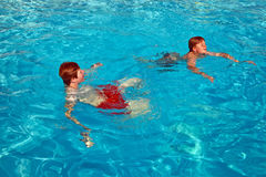 Children having fun in the pool. Two brothers having fun in the pool Stock Photography