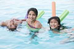 Children having fun in pool Stock Images