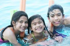 Children having fun in pool. Children having fun in swimming pool Stock Photography