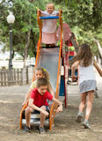 Children having fun on slide at playground Royalty Free Stock Image