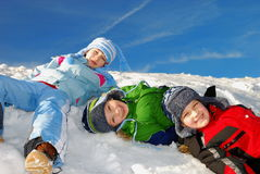 Children having fun in snow Royalty Free Stock Image