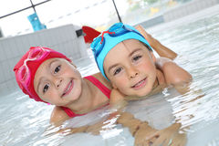 Children having fun in swimming pool royalty free stock photography