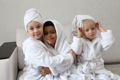 Children having fun after taking a shower stock photo