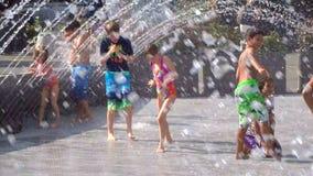 Children Having Fun at the Water Fountain stock video