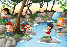 Children having fun at the waterfall Stock Photography