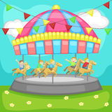 Children having a good time in a carousel Royalty Free Stock Photo